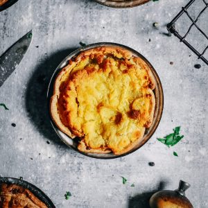 Baked snapper pie with peas, topped with potato puree.