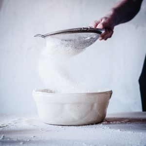 flour sifted over bowl